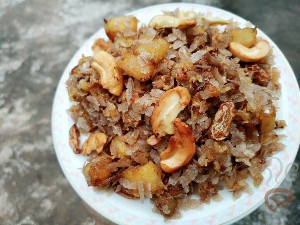 Aval Ethapazham Varattiyathu | Beaten Brown Rice Flakes And Ripe Plantains Cooked With Jaggery And Coconut